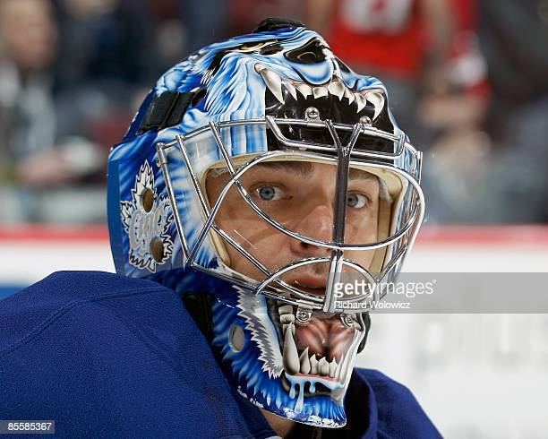Curtis Joseph of the Toronto Maple Leafs watches play during the warm up period prior to facing the Montreal Canadiens at the Bell Centre on March...