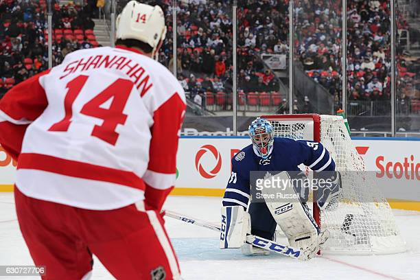 TORONTO ON DECEMBER 31 Curtis Joseph protects the net as Brendan Shanahan comes in as the Toronto Maple Leafs alumni lose to the Detroit Red Wings...