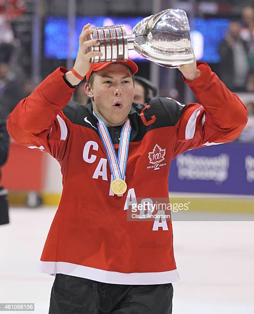 Curtis Lazar of Team Canada hoists the winning trophy after defeating Team Russia in the Gold medal game in the 2015 IIHF World Junior Hockey...