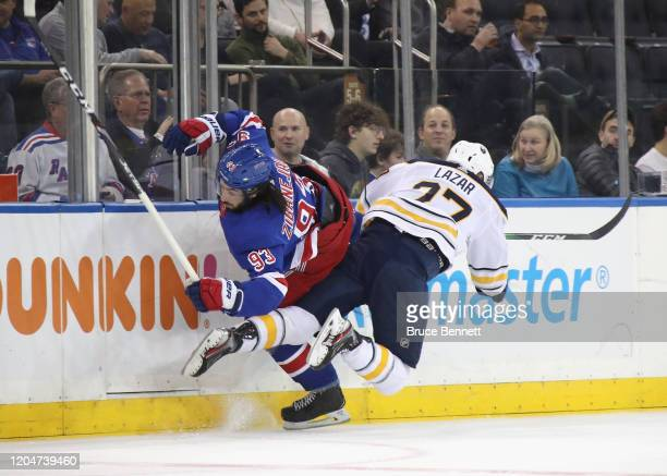 Curtis Lazar of the Buffalo Sabres checks Mika Zibanejad of the New York Rangers at Madison Square Garden on February 07 2020 in New York City The...