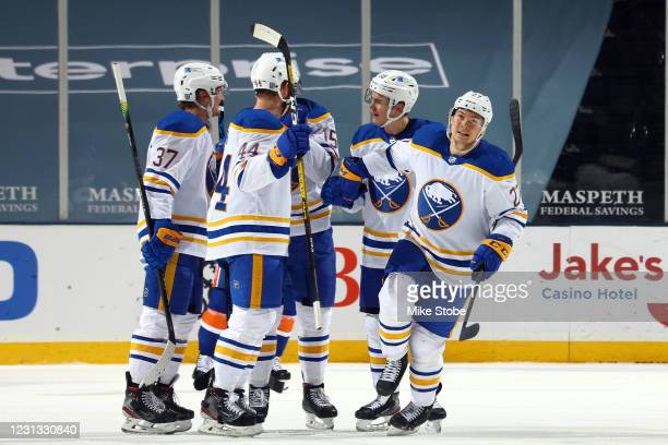 Curtis Lazar of the Buffalo Sabres is congratulated by his teammates after scoring a goal against the New York Islanders during the first period at...