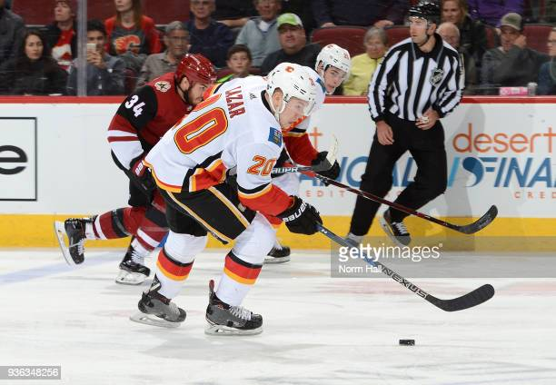 Curtis Lazar of the Calgary Flames skates with the puck against the Arizona Coyotes at Gila River Arena on March 19 2018 in Glendale Arizona