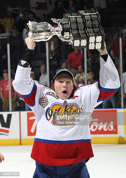 Curtis Lazar of the Edmonton Oil Kings hoists the MasterCard Memorial Cup after defeating the Guelph Storm in the final of the 2014 MasterCard...