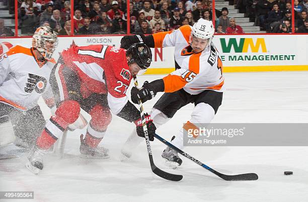 Curtis Lazar of the Ottawa Senators is stopped form getting to a loose puck by the stickcheck of Michael Del Zotto of the Philadelphia Flyers at...