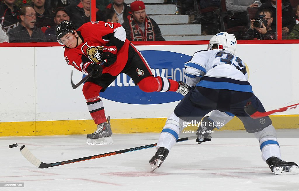 Curtis Lazar #27 of the Ottawa Senators shoots the puck past Tobias Enstrom #39 of the Winnipeg Jets at Canadian Tire Centre on November 8, 2014 in Ottawa, Ontario, Canada.