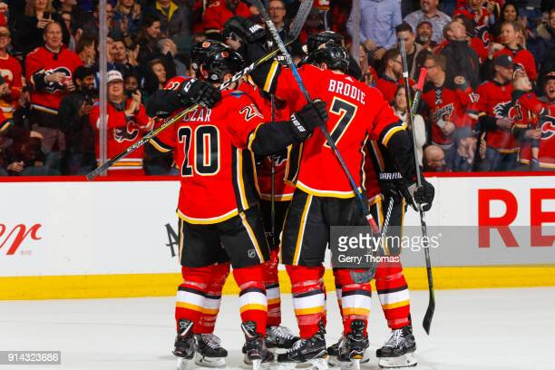 Curtis Lazar TJ Brodie and teammates of the Calgary Flames celebrate in an NHL game on February 1 2018 at the Scotiabank Saddledome in Calgary...