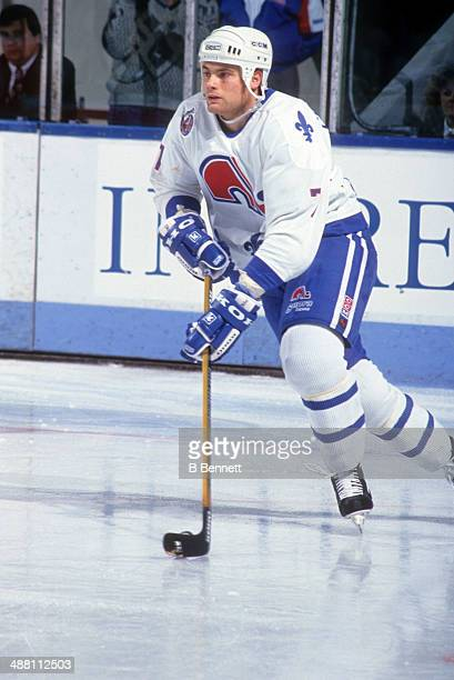 Curtis Leschyshyn of the Quebec Nordiques skates with the puck during an NHL game in December 1992 at the Quebec Coliseum in Quebec City Quebec Canada