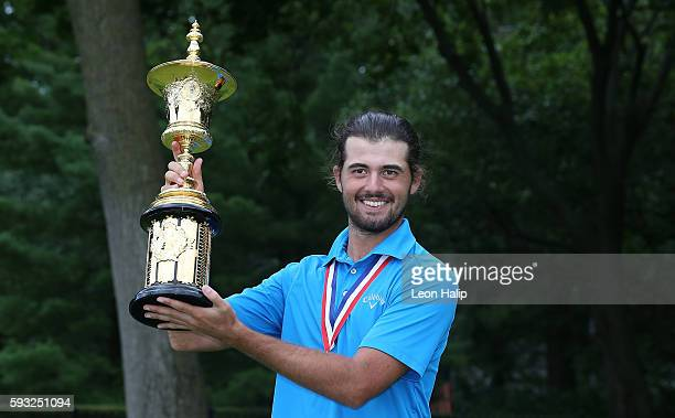 Curtis Luck from Australia celebrates with the Havemeyer Trophy after defeating Brad Dalke from Norman Oklahoma 64 to win the US Amateur Championship...