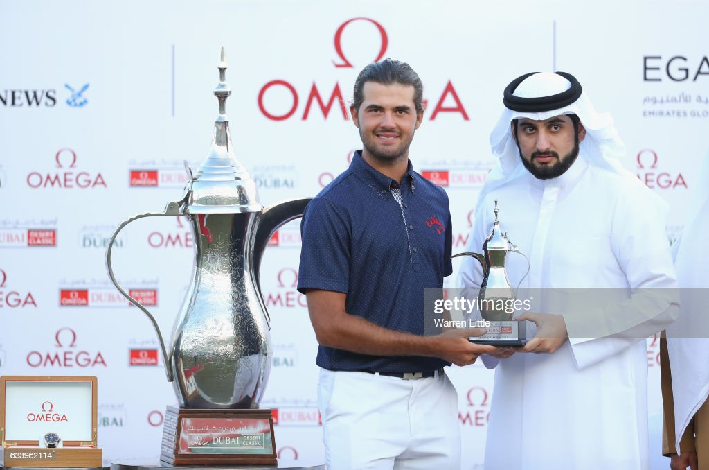 Curtis Luck of Australia is presented the leading amateur trophy by His Highness Shaikh Ahmed Bin Mohammed Bin Rashid Al Maktoum the President of the UAE National Olympic Committee after the final round of the Omega Dubai Desert Classic on the Majlis course at Emirates Golf Club on February 5, 2017 in Dubai, United Arab Emirates.