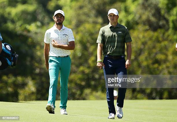 Curtis Luck of Australia walks with Jordan Spieth of the United States down the 7th fairway during day one of the 2016 Australian Open at Royal...