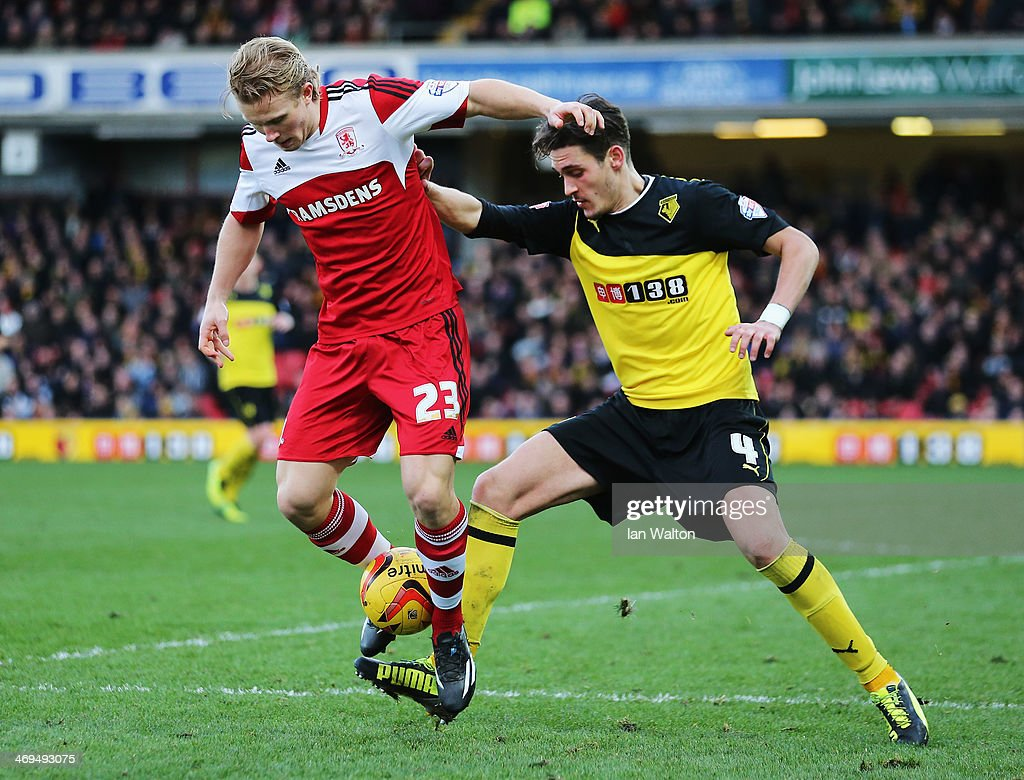 Curtis Main of Middlesbrough and Gabriele Angella of Watford challenge for the ball during the Sky Bet Championship match between Watford and Middlesbrough at Vicarage Road on February 15, 2014 in Watford, England.