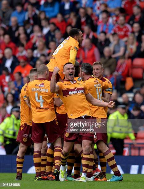 Curtis Main of Motherwell celebrates scoring the opening goal of the game with his team mates during the Scottish Cup Semi Final match between...