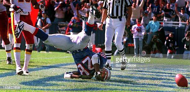 Curtis Martin did everything to try and bring a victory to the Patriots Here he loses the ball but has already broken the plane of the goal line...
