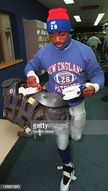 Curtis Martin is dressed for the cold as he heads out of the Patriots locker room