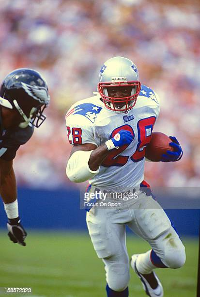 Curtis Martin of the New England Patriots carries the ball against the Philadelphia Eagles during a preseason NFL football game circa 1996 at Foxboro...