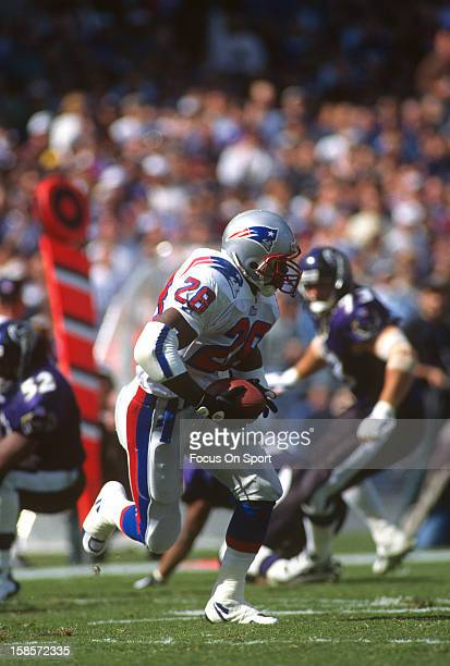Curtis Martin of the New England Patriots carries the ball against the Baltimore Ravens during an NFL football game October 6 1996 at Memorial...