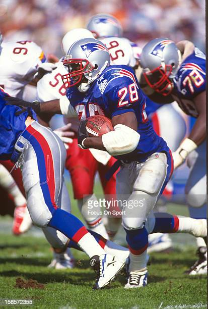 Curtis Martin of the New England Patriots carries the ball against the Arizona Cardinals during an NFL football game September 15 1996 at Foxboro...
