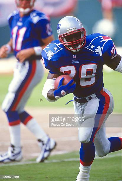 Curtis Martin of the New England Patriots carries the ball against the Miami Dolphins during an NFL football game September 1 1996 at Pro Player...