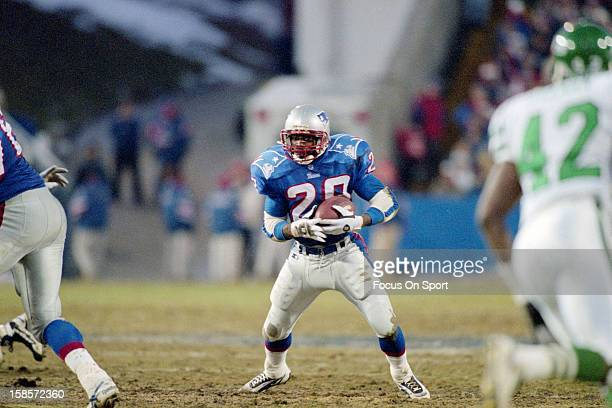 Curtis Martin of the New England Patriots carries the ball against the New York Jets during an NFL football game December 8 1996 at Foxboro Stadium...