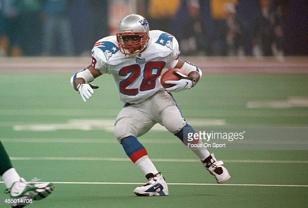 Curtis Martin of the New England Patriots carries the ball against the Green Bay Packers during Super Bowl XXXI January 26 1997 at the Louisiana...