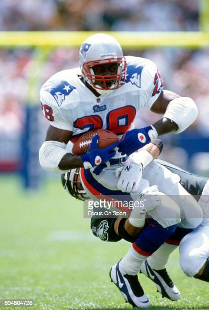 Curtis Martin of the New England Patriots carries the ball against the Philadelphia Eagles during an NFL football game circa 1996 at Foxboro Stadium...