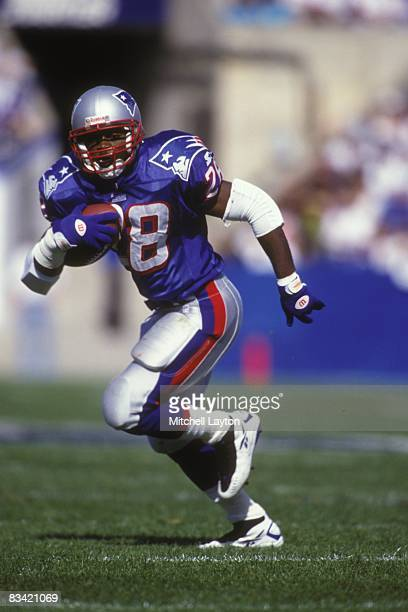 Curtis Martin of the New England Patriots rusn with the ball during a NFL football game against the Buffalo Bills on October 12 1997 at Gillette...