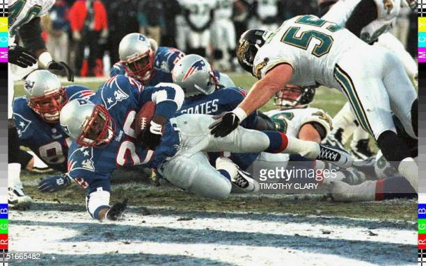 Curtis Martin of the New England Patriots scores a touchdown on a oneyard run in the first quarter of the AFC championship game against the...
