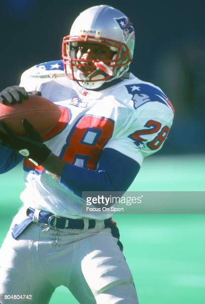 Curtis Martin of the New England Patriots warms up prior to the start of an NFL football game circa 1996 Martin played for the Patriots from 199597