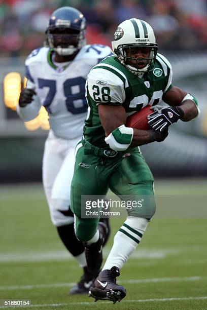 Curtis Martin of the New York Jets outruns Antonio Cochran of the Seattle Seahawks at Giants Stadium on December 19 2004 in East Rutherford New...