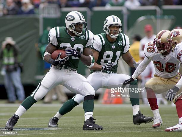 Curtis Martin of the New York Jets runs as Shantae Spencer of the San Francisco 49ers pursues to tackle in the game on October 17, 2004 at Giants...