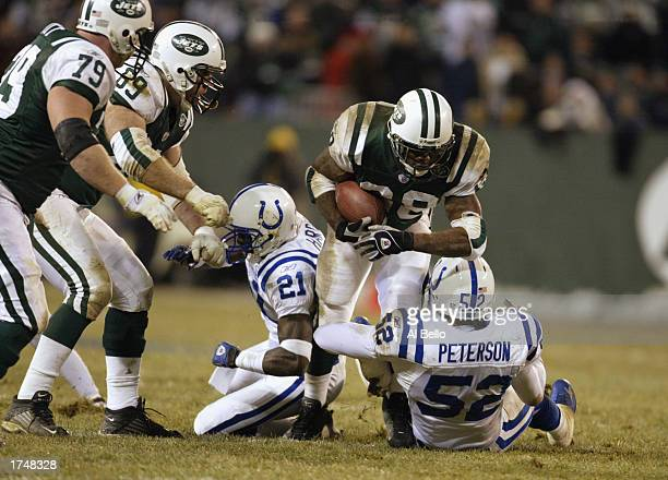 Curtis Martin of the New York Jets runs over Mike Peterson of the Indianapolis Colts during the AFC wildcard game on at Giants Stadium January 4 2003...