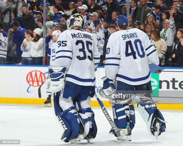 Curtis McElhinney and Garret Sparks of the Toronto Maple Leafs skate off the ice following their 52 victory against the Buffalo Sabres in an NHL game...