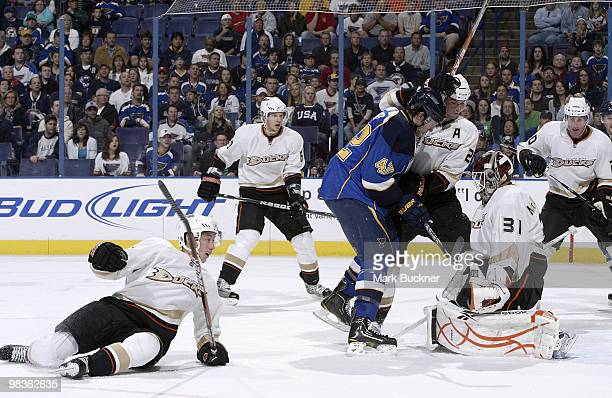 Curtis McElhinney and Sheldon Brookbank of the Anaheim Ducks defend against David Backes of the St Louis Blues as Dan Sexton falls to the ice on...