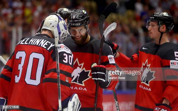 Curtis McElhinney goaltender of Canada celebrate with team mate Aaron Ekblad after the 2018 IIHF Ice Hockey World Championship group stage game...