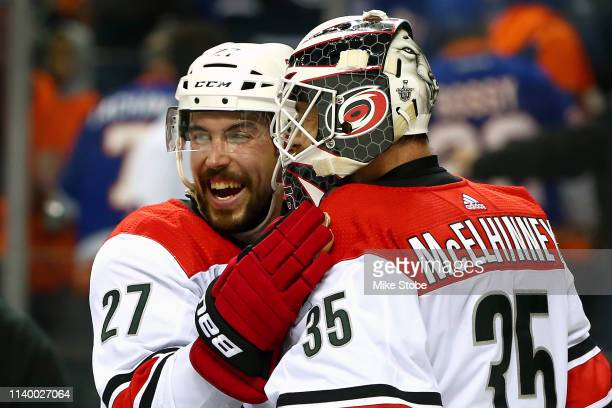 Curtis McElhinney is congratulated by his teammate Justin Faulk after their 21 win over the New York Islanders in Game Two of the Eastern Conference...