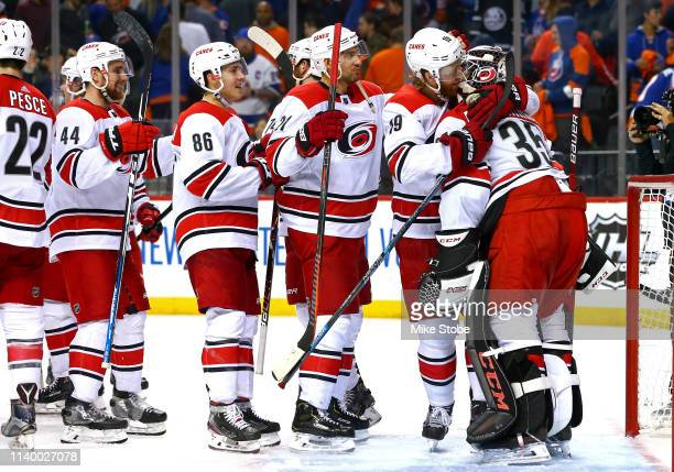 Curtis McElhinney is congratulated by his teammates after their 21 win over the New York Islanders in Game Two of the Eastern Conference Second Round...