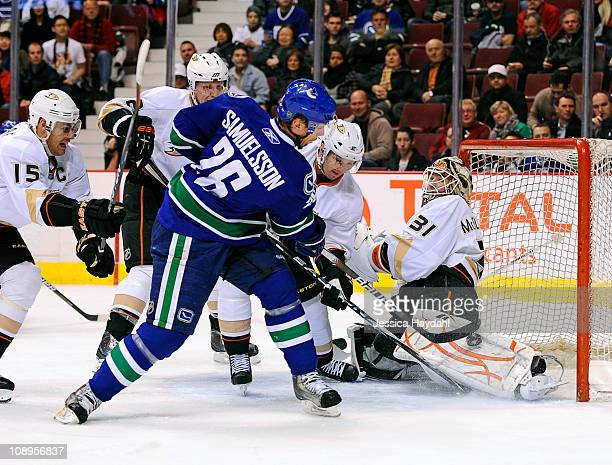 Curtis McElhinney of the Anaheim Ducks makes a save on Jannik Hansen of the Vancouver Canucks while Ryan Getzlaf Lubomir Visnovsky and Toni Lydman of...