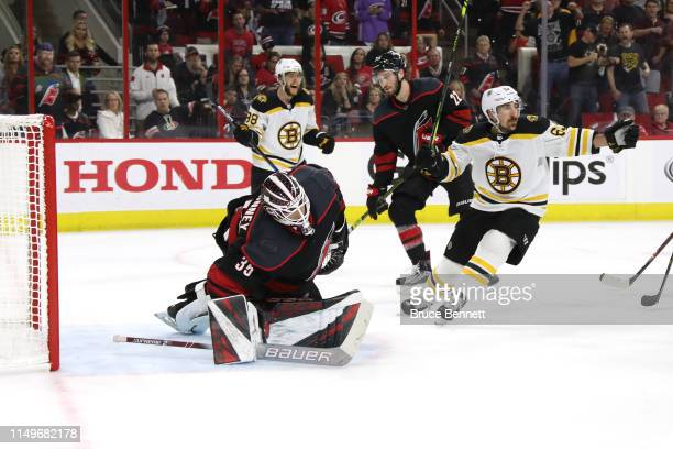 Curtis McElhinney of the Carolina Hurricanes gives up a goal to Patrice Bergeron of the Boston Bruins during the second period in Game Four of the...