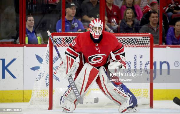 Curtis McElhinney of the Carolina Hurricanes keeps his eye on the puck during an NHL game against the Vancouver Canucks on October 9 2018 at PNC...