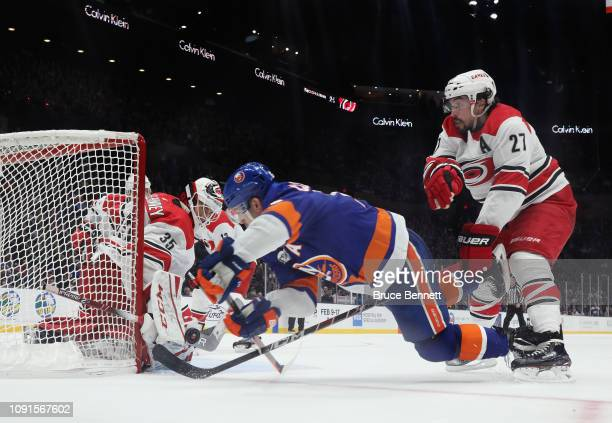 Curtis McElhinney of the Carolina Hurricanes makes the save on Jordan Eberle of the New York Islanders at NYCB Live at the Nassau Veterans Memorial...