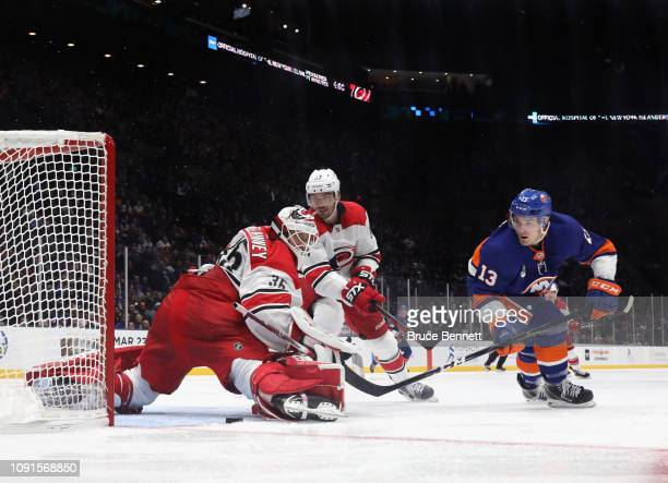 Curtis McElhinney of the Carolina Hurricanes makes the third period save on Mathew Barzal of the New York Islanders at NYCB Live at the Nassau...