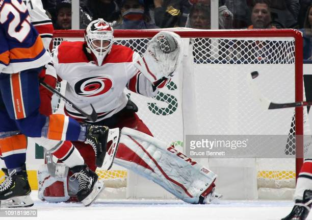 Curtis McElhinney of the Carolina Hurricanes tends net against the New York Islanders at NYCB Live at the Nassau Veterans Memorial Coliseum on...
