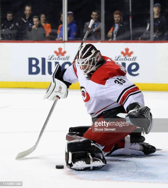 Curtis McElhinney of the Carolina Hurricanes tends net against the New York Islanders in Game Two of the Eastern Conference Second Round during the...