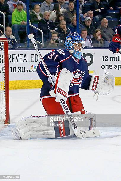 Curtis McElhinney of the Columbus Blue Jackets follows the puck during the game against the Ottawa Senators on January 28 2014 at Nationwide Arena in...