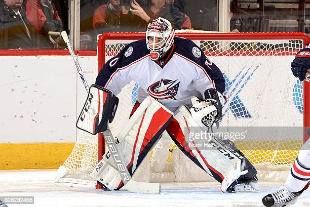 Curtis McElhinney of the Columbus Blue Jackets gets ready to make a save against the Arizona Coyotes at Gila River Arena on December 3 2016 in...