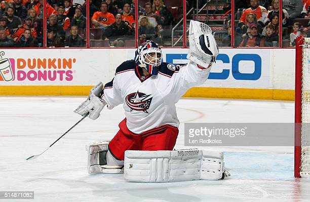 Curtis McElhinney of the Columbus Blue Jackets makes a glove save against the Philadelphia Flyers on March 5 2016 at the Wells Fargo Center in...