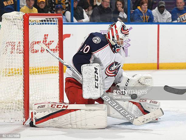 Curtis McElhinney of the Columbus Blue Jackets makes a save against the St Louis Blues on November 5 2016 at Scottrade Center in St Louis Missouri