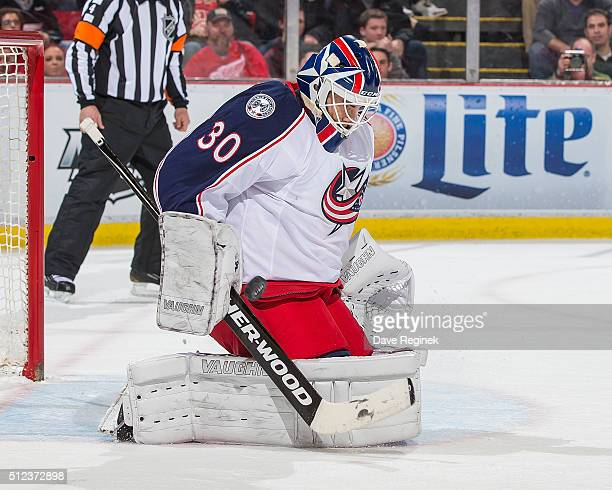 Curtis McElhinney of the Columbus Blue Jackets makes a save during an NHL game against the Detroit Red Wings at Joe Louis Arena on February 23 2016...