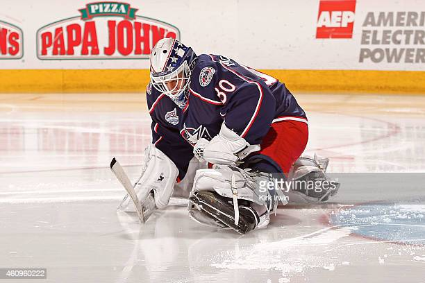 Curtis McElhinney of the Columbus Blue Jackets stretches prior to the start of the second period of the game against the Boston Bruins on December 27...