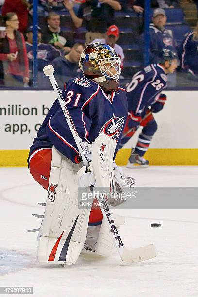 Curtis McElhinney of the Columbus Blue Jackets warms up prior to the start of the game against the Detroit Red Wings on March 11 2014 at Nationwide...